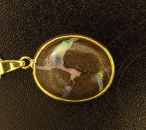 Figure 3: Rear of the pendant showing ironstone with precious opal streak.