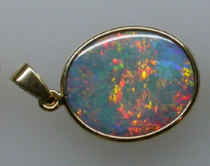 Figure 1: Solid opal or opal doublet (composite)